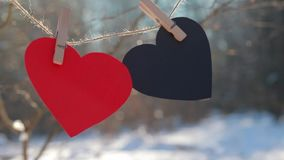 Valentines day, Valentine`s day,Love. Two red heart, symbol of love, Happy Valentines Day background. Decorative white wooden hearts on grey rustic wooden stock video footage