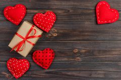 Free Valentines Day Vintage Background With Hearts And A Gift Box On Wooden Table Stock Photography - 107964742