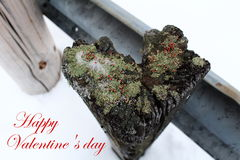 Valentines day: weathered Wooden Post heart-shaped. With the phrase Happy Valentines day Royalty Free Stock Image
