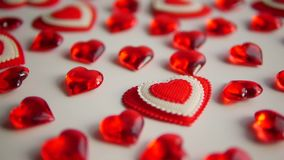 Valentines Day White Background. Red hearts lay on a white background. How to get ahead stock video footage