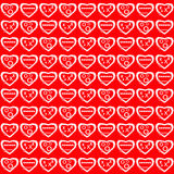 Valentines Day. White hearts, with varying patterns, against a bright red background stock photography