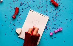 Valentines Day Wishes. Note book on blue background with sparkle. S. Planning concept. Flat lay, top view. Closeup, copy space stock photo