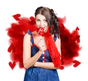 Valentines day woman eating heart candy Royalty Free Stock Photos