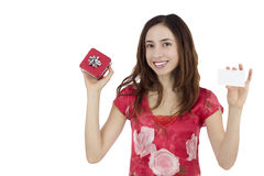 Valentines day woman with a gift card. Happy smiling woman showing gift card and gift box Stock Image