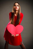 Valentines Day woman holding heart. Stock Photography