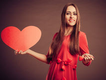 Valentines Day woman holding heart. Royalty Free Stock Image