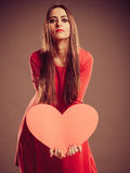 Valentines Day woman holding heart. Stock Image
