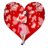 Valentines day woman holding love heart card Stock Images