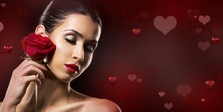 Valentines Day Woman holding red rose Stock Photo