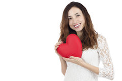 Valentines day woman showing a big red heart. Love and valentines day woman smiling and holding a re heart, isolated on white background Royalty Free Stock Images