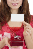 Valentines day woman showing a gift card Royalty Free Stock Photo