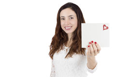 Valentines day woman showing love letter. Valentines day woman showing card with copy space Royalty Free Stock Image