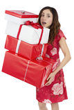 Valentines day woman tired of carrying heavy gift packages. Love and valentines day woman exhausted of carrying gift packages, isolated on white background Stock Photography