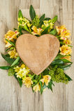 Valentines Day wooden heart. Pink wooden heart and flowers with place for text on the wooden background Royalty Free Stock Photo