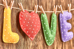 Love, Valentines Day. Word polka dots, heart wood. Love, Valentines Day. Word Love polka dots, Heart Handmade, hanging on rope. Retro vintage romantic style Royalty Free Stock Photo