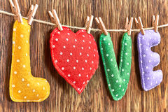 Love, Valentines Day. Word polka dots, heart wood. Love, Valentines Day. Word Love polka dots, Heart Handmade, hanging on rope. Retro vintage romantic style Royalty Free Stock Images