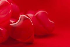 valentines de rouge de coeurs de fond Images libres de droits