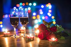 Valentines dinner romantic love concept / Romantic table setting decorated with couple champagne glass wine royalty free stock images