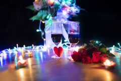 Valentines dinner romantic love concept / Romantic table setting decorated with red heart and couple champagne glass stock photo