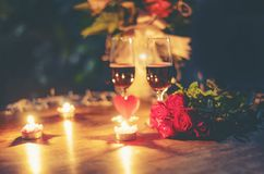 Valentines dinner romantic love concept Romantic table setting decorated with Red heart and couple champagne glass roses flower stock images
