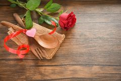 Valentines dinner romantic love food and love cooking concept Romantic table setting decorated with wooden fork spoon roses flower royalty free stock photography