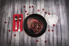 Valentines dinner on wood table with chocolates Stock Photography