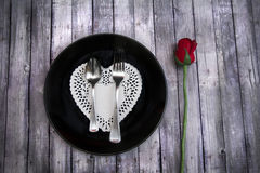 Valentines dinner on wood table with heart doily Stock Photos