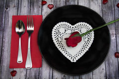 Valentines dinner on wood table with rose Royalty Free Stock Images