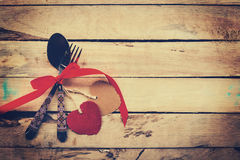 Valentines dinner on wooden background with space.