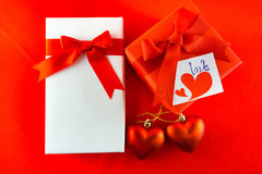 Valentines gift box with a red bow on red background Image of Va Royalty Free Stock Photography