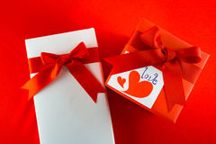 Valentines gift box with a red bow on red background Image of Va Stock Photo