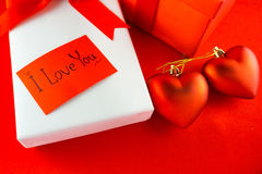 Valentines gift box with a red bow on red background Image of Va Stock Photography