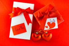 Valentines gift box with a red bow on red background Image of Va Stock Photos