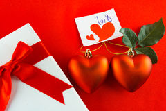 Valentines gift box with a red bow on red background Image of Va Stock Image