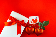 Valentines gift box with a red bow on red background Image of Va Stock Images