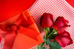 Valentines gift box with a red bow on red background Image of Va Royalty Free Stock Photos