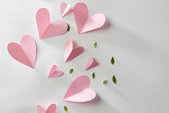 Valentines gift card. Pink hearts with green leaves on a white background with space for text Royalty Free Stock Image