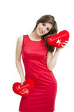 Valentines Girl holding hearts. Beautiful Girl in red dress holding two hearts      ; Happy Valentines sign, isolated on white Royalty Free Stock Image