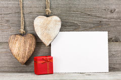 Valentines greeting card with gift box and hearts Stock Photo