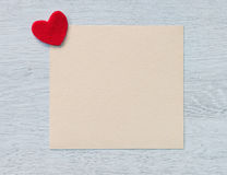 Valentines greeting card with a red heart Stock Photography
