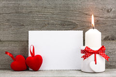 Valentines greeting card with two red hearts and candle Royalty Free Stock Images