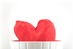 Valentines hand-made heart over white. Valentines hand-made heart in a flower pot over white Stock Photo