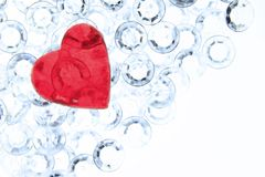Valentines heart. Red heart on glittering plastic gravel - Symbolically love - Valentine's Day Royalty Free Stock Image