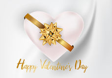 Valentines heart and gold bow white text on rippled white silk f Royalty Free Stock Image