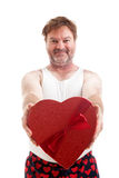 Valentines Heart Guy. Scruffy middle aged man giving you a heart shaped box of candy for Valentines Day. Isolated on white stock photos