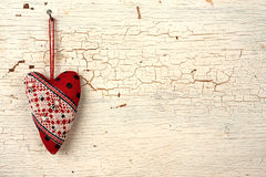 Valentines heart on a   old wooden door. Heart symbol  hand made on a white old wooden background Royalty Free Stock Images