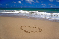 Valentines heart on sand on beach Royalty Free Stock Photography