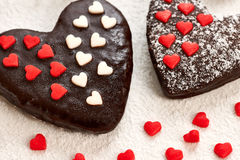 Valentines Hearts chocolate cakes Couple on sugar powder background Royalty Free Stock Photos