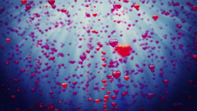 Valentines Hearts raising against dark blue. Stock footage stock footage