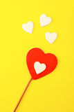 Valentines hearts. Valentine's day cheerful hearts on yellow background Stock Images